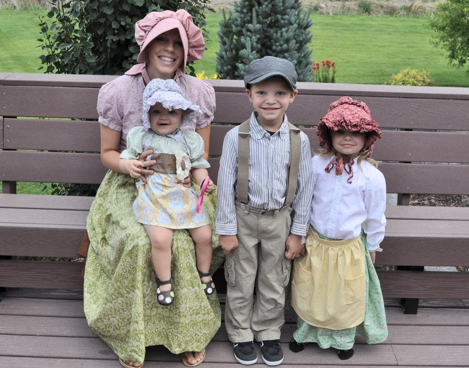 Family dressed up as pioneers