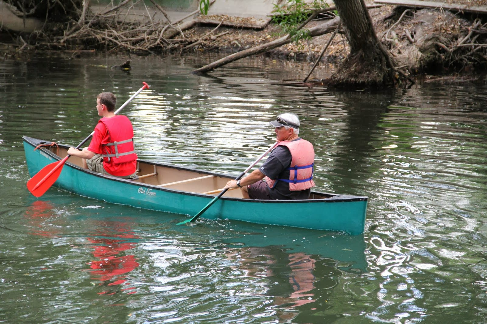 2 men canoeing down Provo River