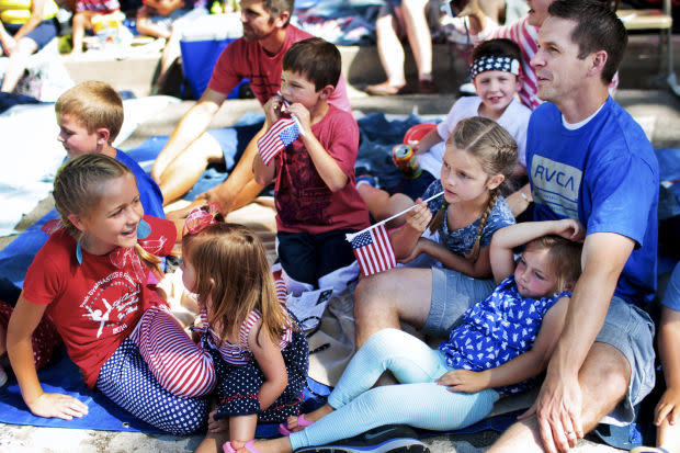 Family sitting in the shade watching parade