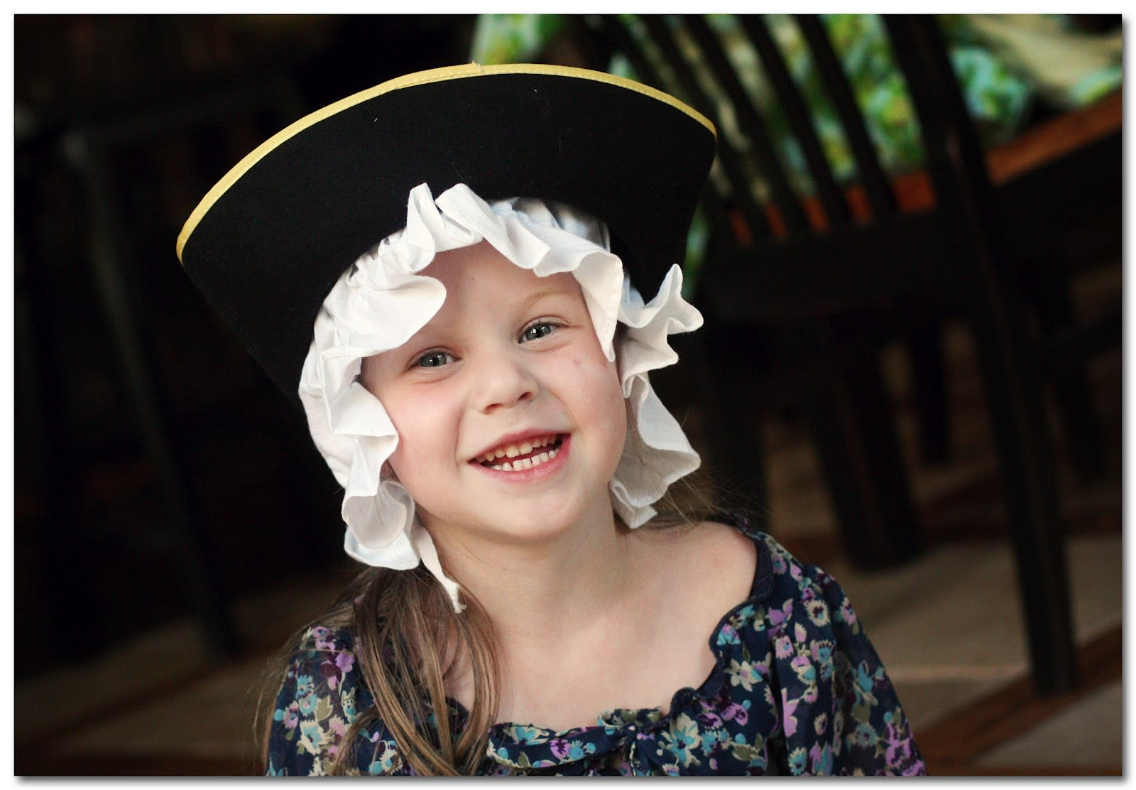 A young girl dressed in Colonial clothes
