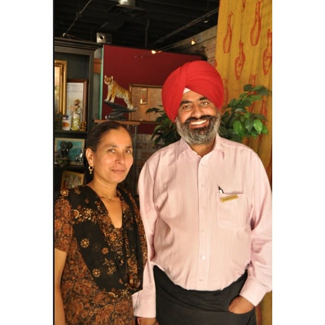 Owner Amrik Singh and his wife