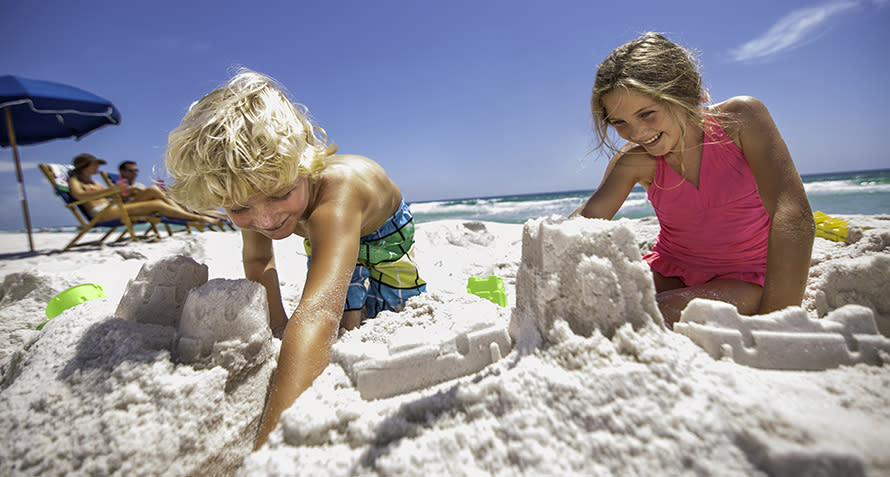 Kids building sandcastles