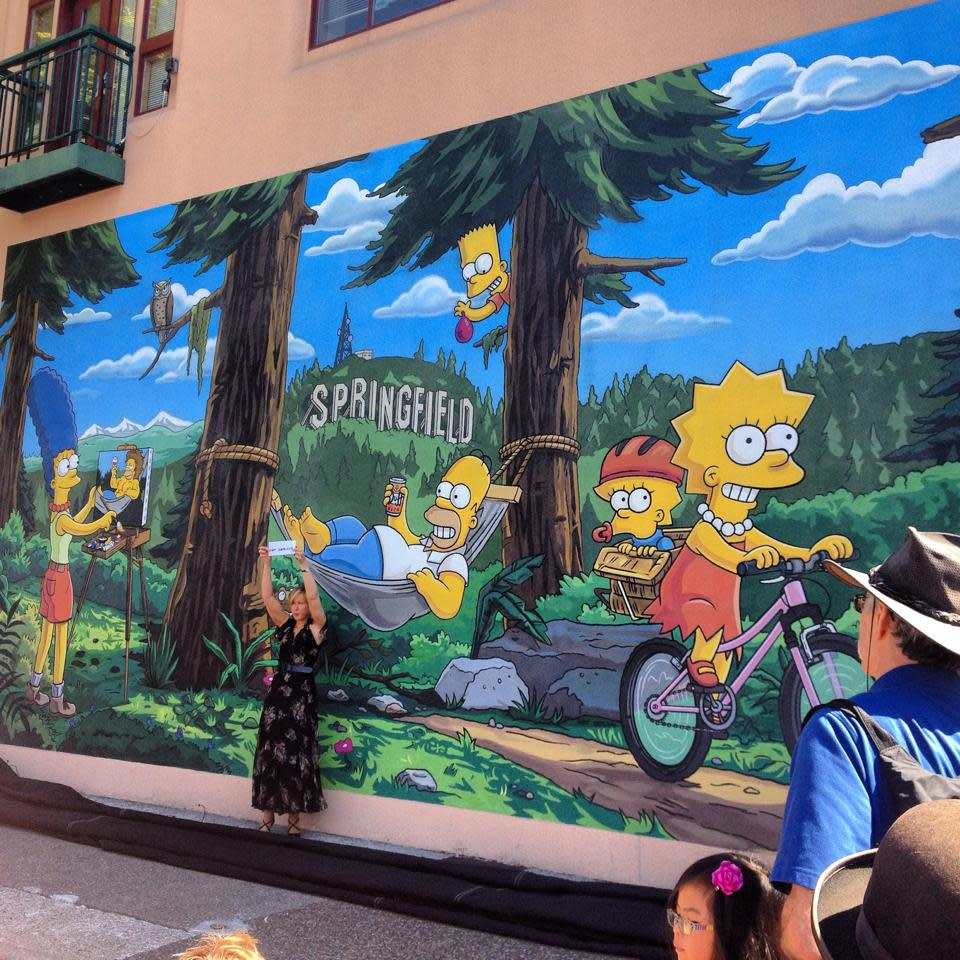 Yeardley Smith, the voice of Lisa Simpson, helps dedicate The Simpsons' mural at Emerald Arts Center