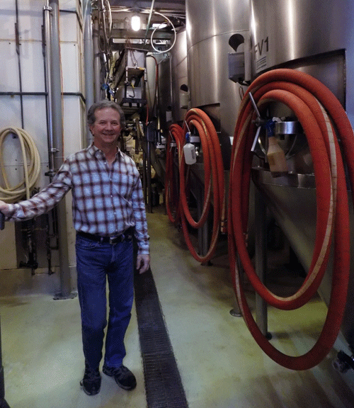 Chuck Magerl stands in his brewery on Mass St. in Lawrence, Kansas.