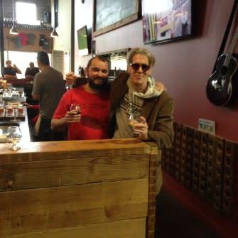 Tom with Ocelot's Sebastian enjoying a beer.