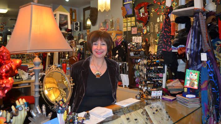 Sherri Tillman behind the desk where she still does hand-written receipts.