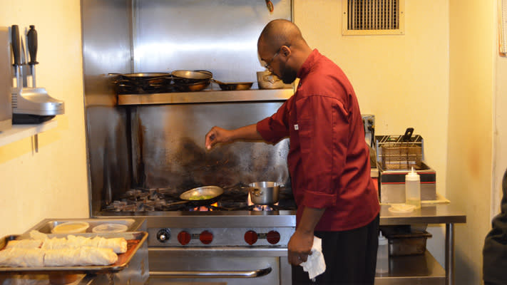Chef Timothy Thomas prepares one of Flora's signature dishes.