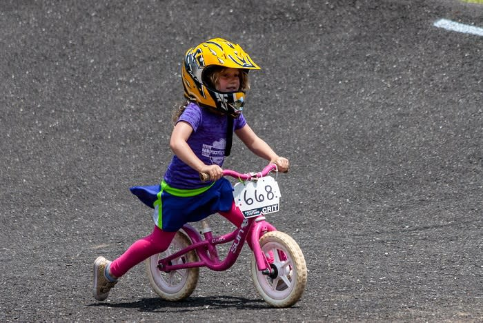 young girl learns to bike