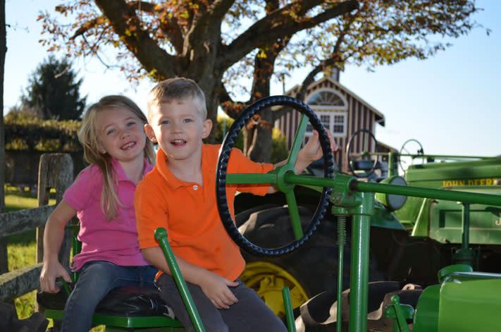 Savannah and Brett Barron aboard Northern Star Farm's tractor.