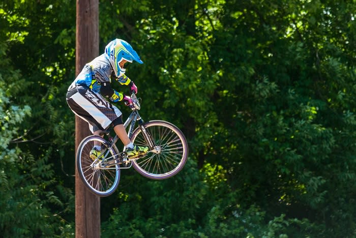 bike trick with greenery
