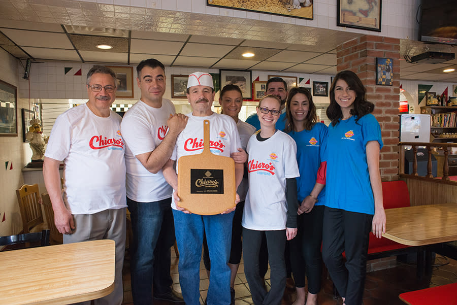 Chiaro's Pizza and Our Staff Show Off the Trophy