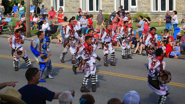 The Caporales San Simon adds international flair to the July 4 festivities.