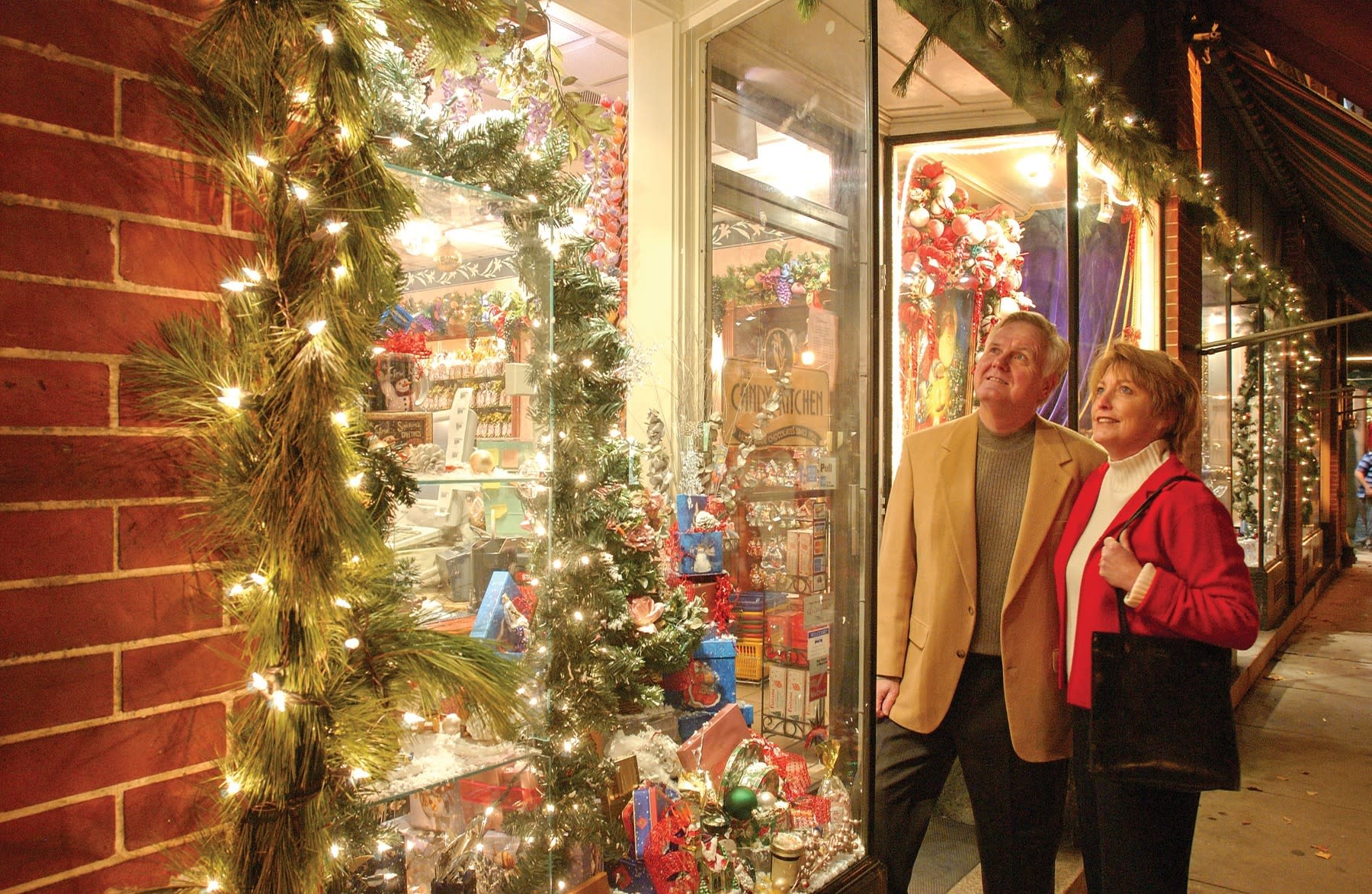 Man and woman window shopping during the holidays in Downtown Frederick