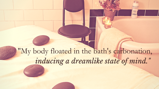 """""""My body floated in the bath's carbonation, inducing a dreamlike state of mind."""" over image of Roosevelt Bath & Spa room"""