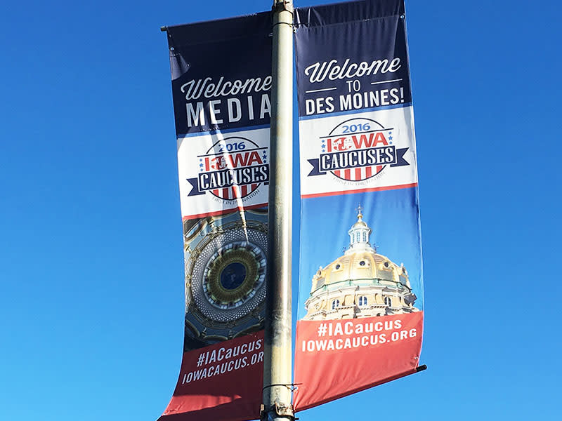 Banners in downtown Des Moines welcome media, campaigns and guests