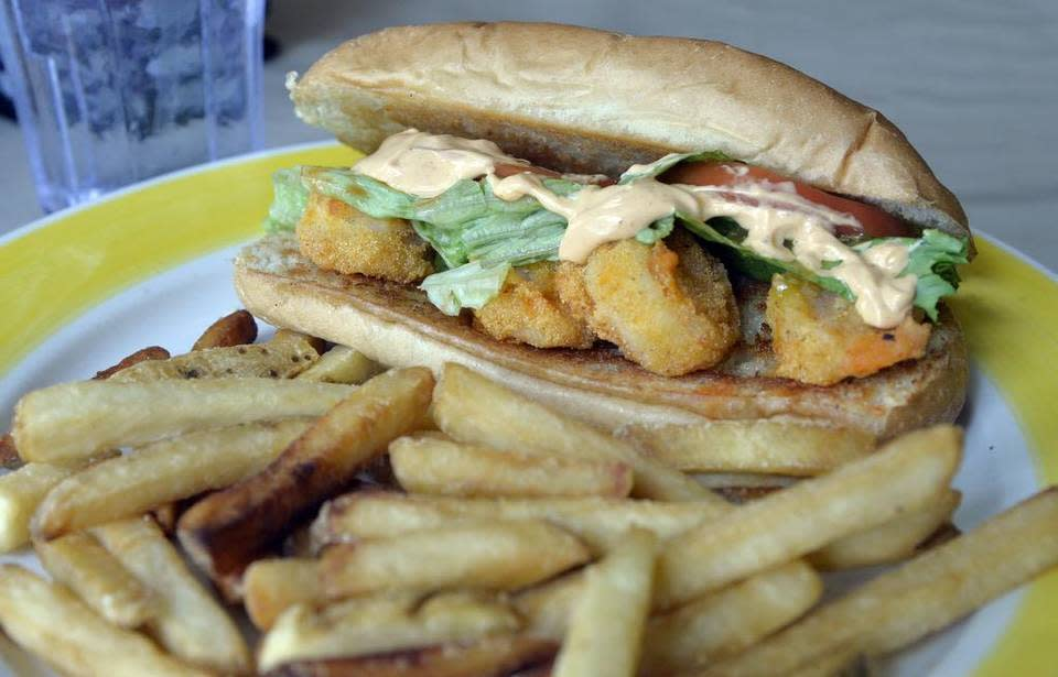 Local Yolkal Cafe in Milledgeville is open for breakfast, lunch and brunch, and among its menu offerings is a shrimp po boy sandwich with fries.