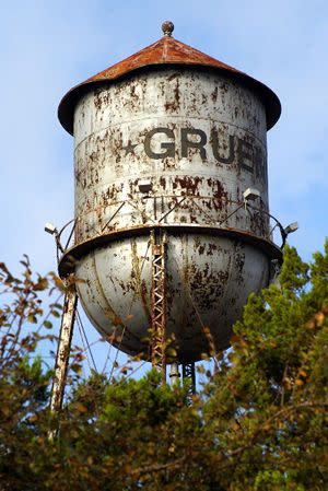 Gruene Texas old water tower, close up showing dent
