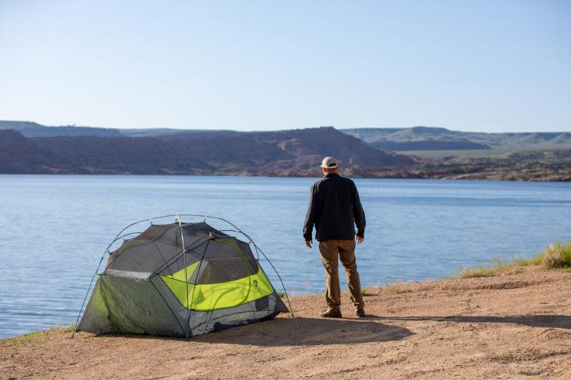 A camper enjoys the view from his Alcova campsite.