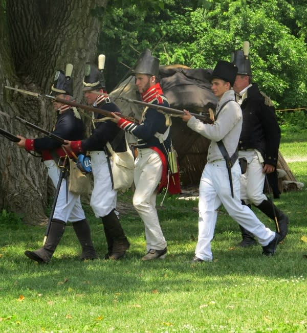 Notice the hats of these 1812 re-enactors? They're called Shakos.