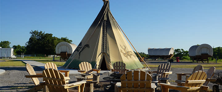 Teepees at Orr Family Farm With Circle Of Lawn Chairs