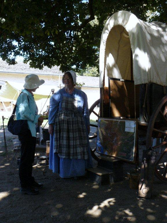 Janet speaks to a docent at Sutter's Fort.