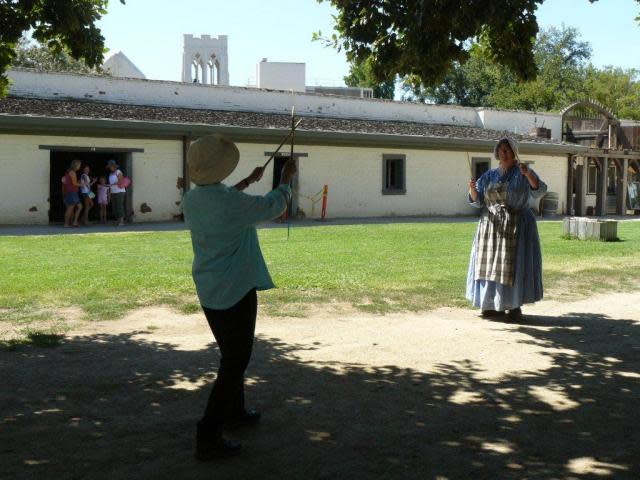 "Janet plays ""Graces"" with a docent at Sutter's Fort"