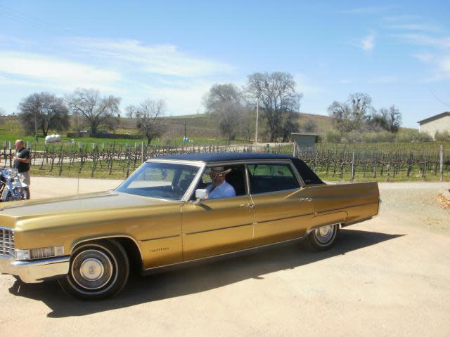 Our friends that we met with in his Gold Caddy