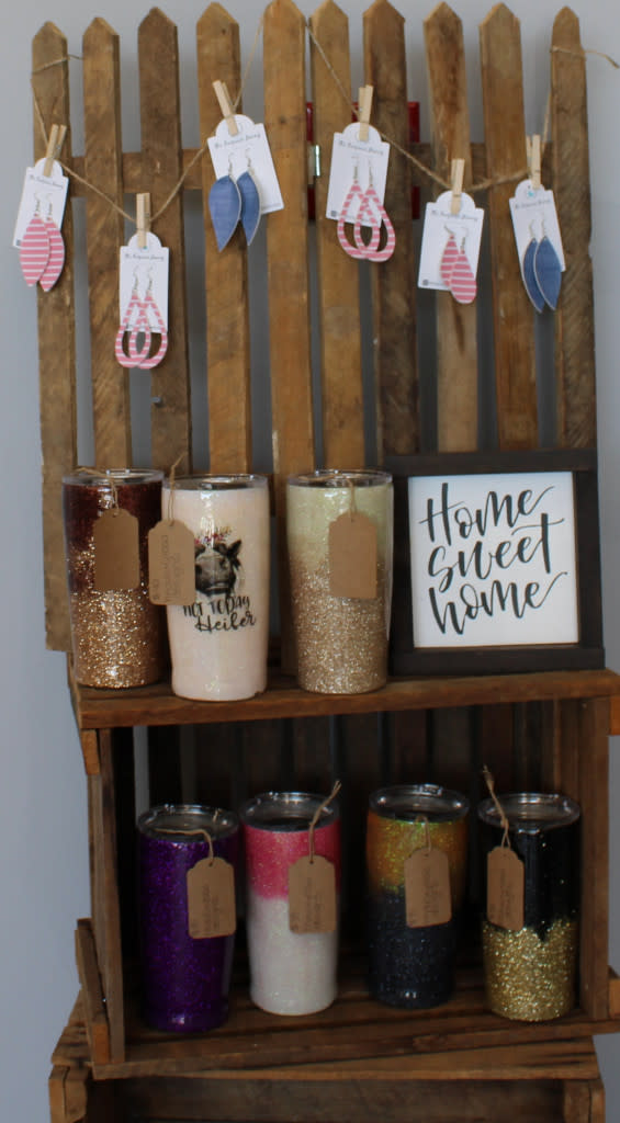 Tumblers, earrings, and signs