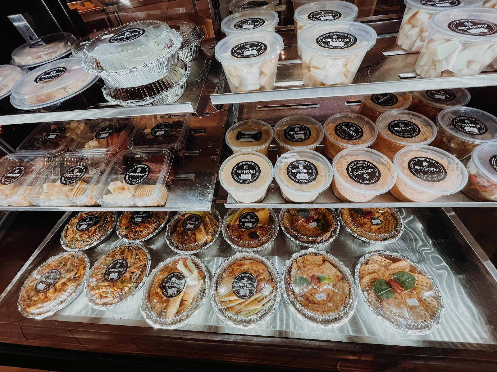 To-go foods from Nosh & Bottle in Irving, TX