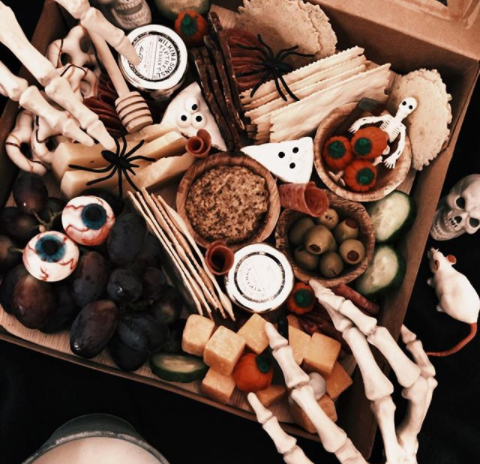 Skeleton Decorations With Servings Of Olives And Cheeses