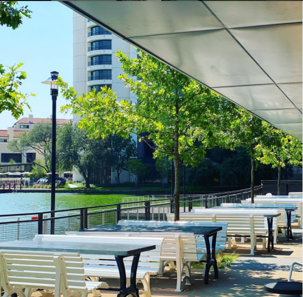 Pacific Table restaurant offers patrons bench seating on the water's edge.