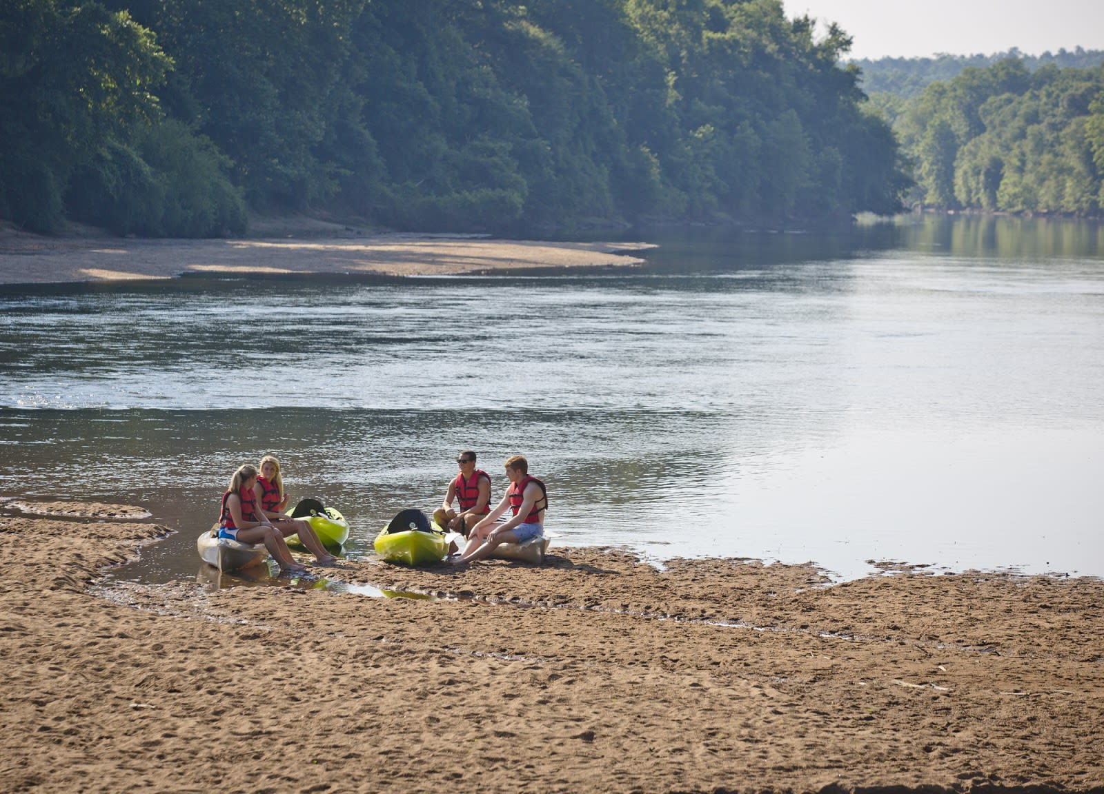 Paddlers take a break on the shores of the Oconee River