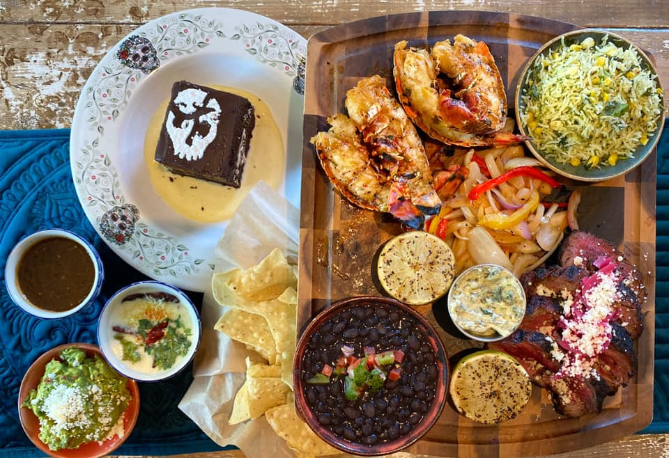 Enjoy an order of surf-and-turf fajitas from Mexican Sugar, with traditional sides of rice and beans.