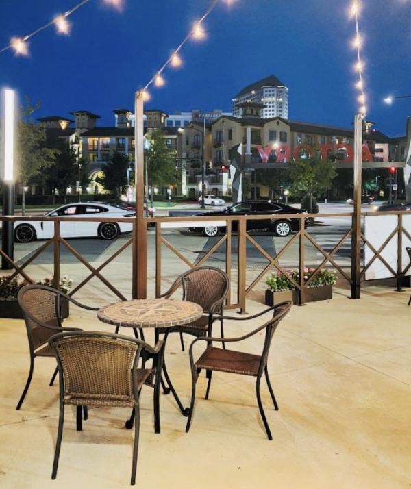 The patio seating at Blaze Brazilian Steakhouse offers a well-lit space for visitors to enjoy their meal.