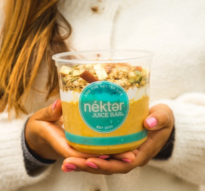 Woman Holding A Bowl From Nekter Juice Bar