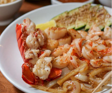 This lobster tail dish from Benihana is served with scallops and shrimp.