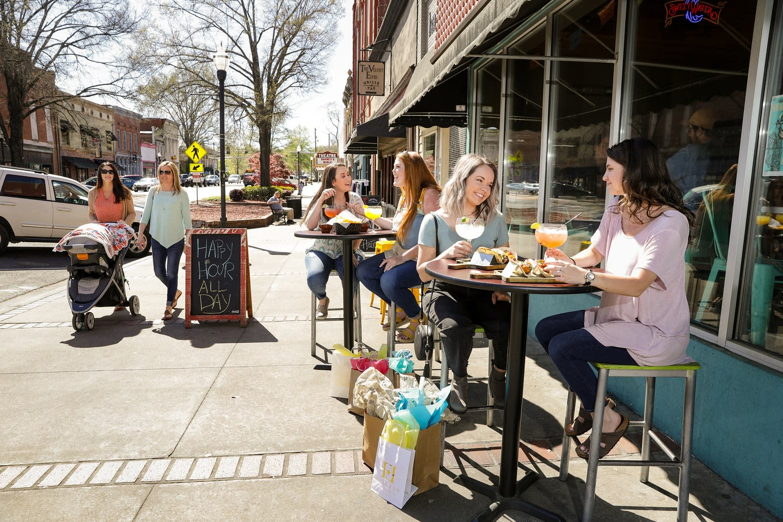 Cityscape of downtown Milledgeville with people milling about