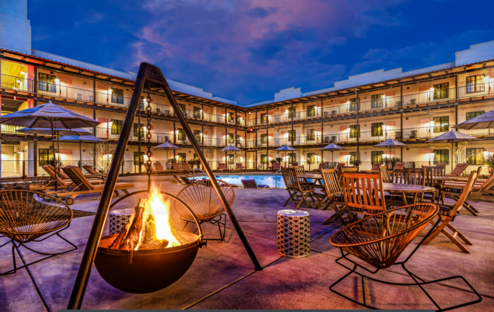 Cozy seating surrounds a unique fire pit near the pool at the Texican Court courtyard.
