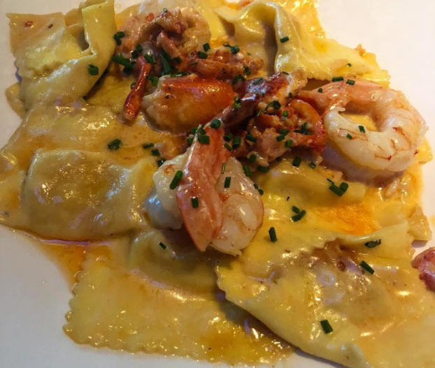 This helping of the Lobster Bisque Agnolotti from Yard House is serves with shrimp and ravioli.