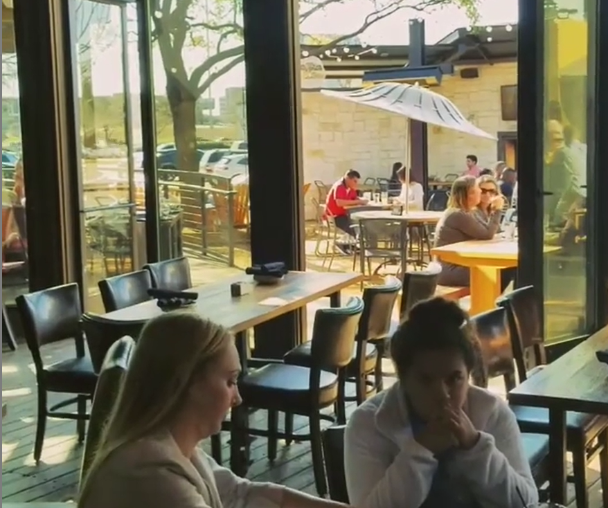 Visitors enjoy the space and fresh are of the indoor/outdoor dining at The Ranch in Las Colinas.