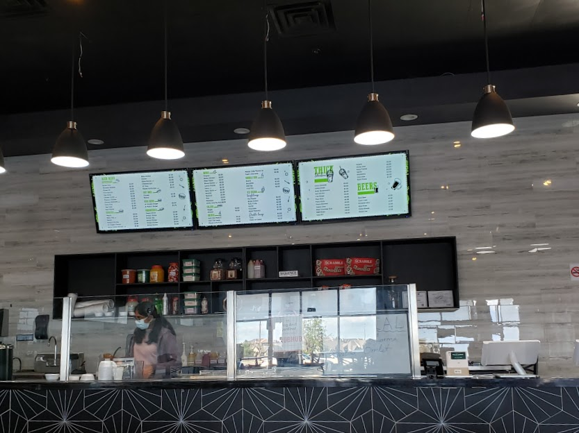 Cashier and Menu Are Of King and Cardinal In Irving, TX