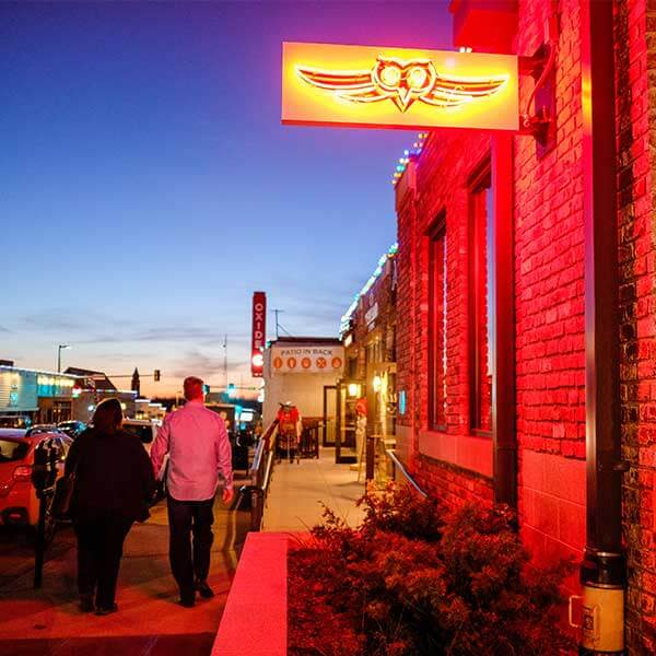 A couple walks by the Nite Owl bar and restaurant on Farnam Street in the Blackstone District of Omaha, Nebraska