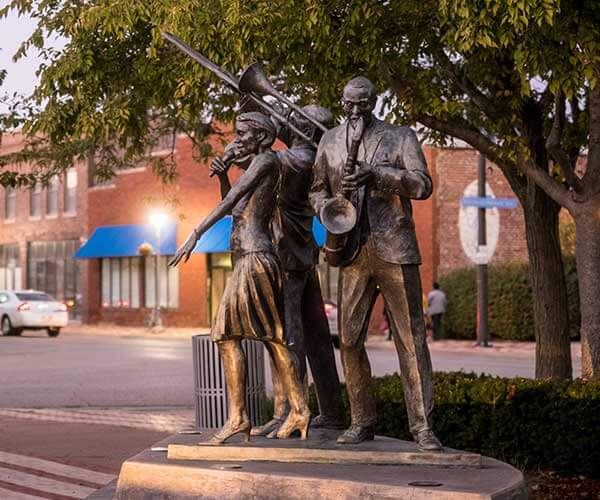 The bronze Jazz Trio sculpture by artist Littleton Alston at Dreamland Plaza on North 24th Street in Omaha, Nebraska