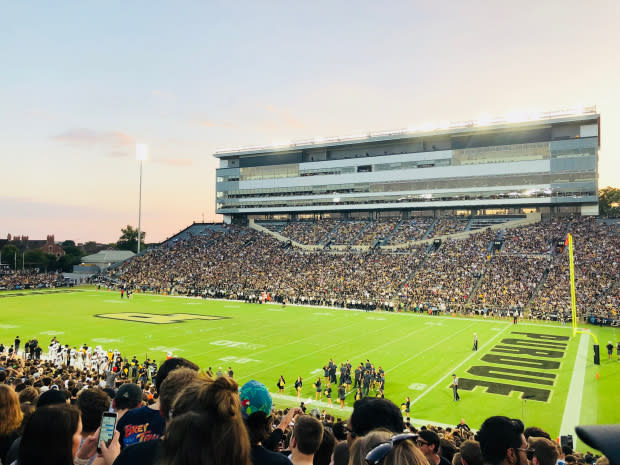 Photo of Ross-Ade stadium filled with fans during a game timeout at sunset