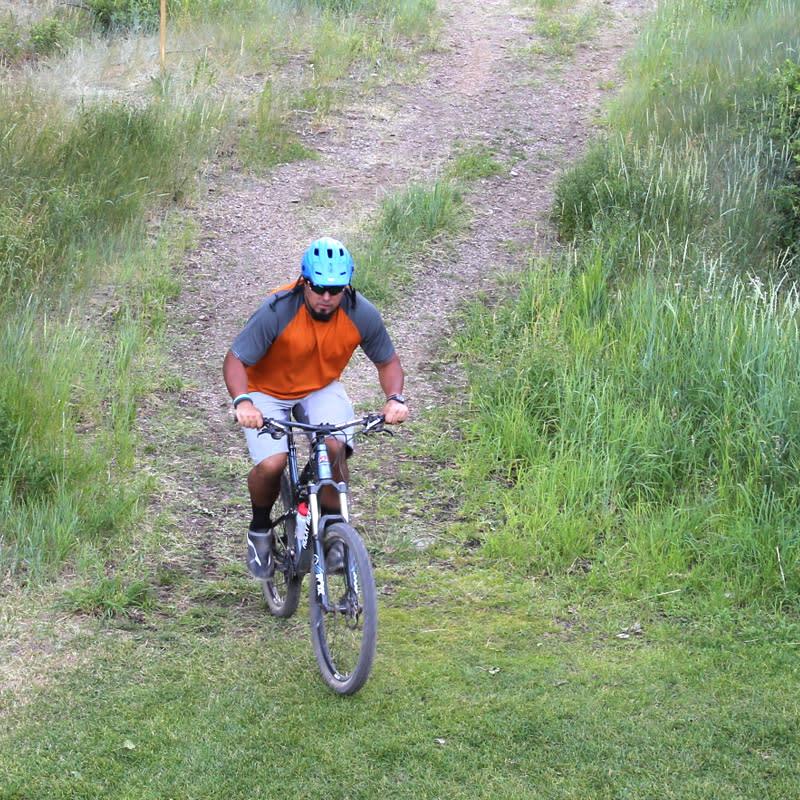 Mountain biker navigates a bike trail in Park City