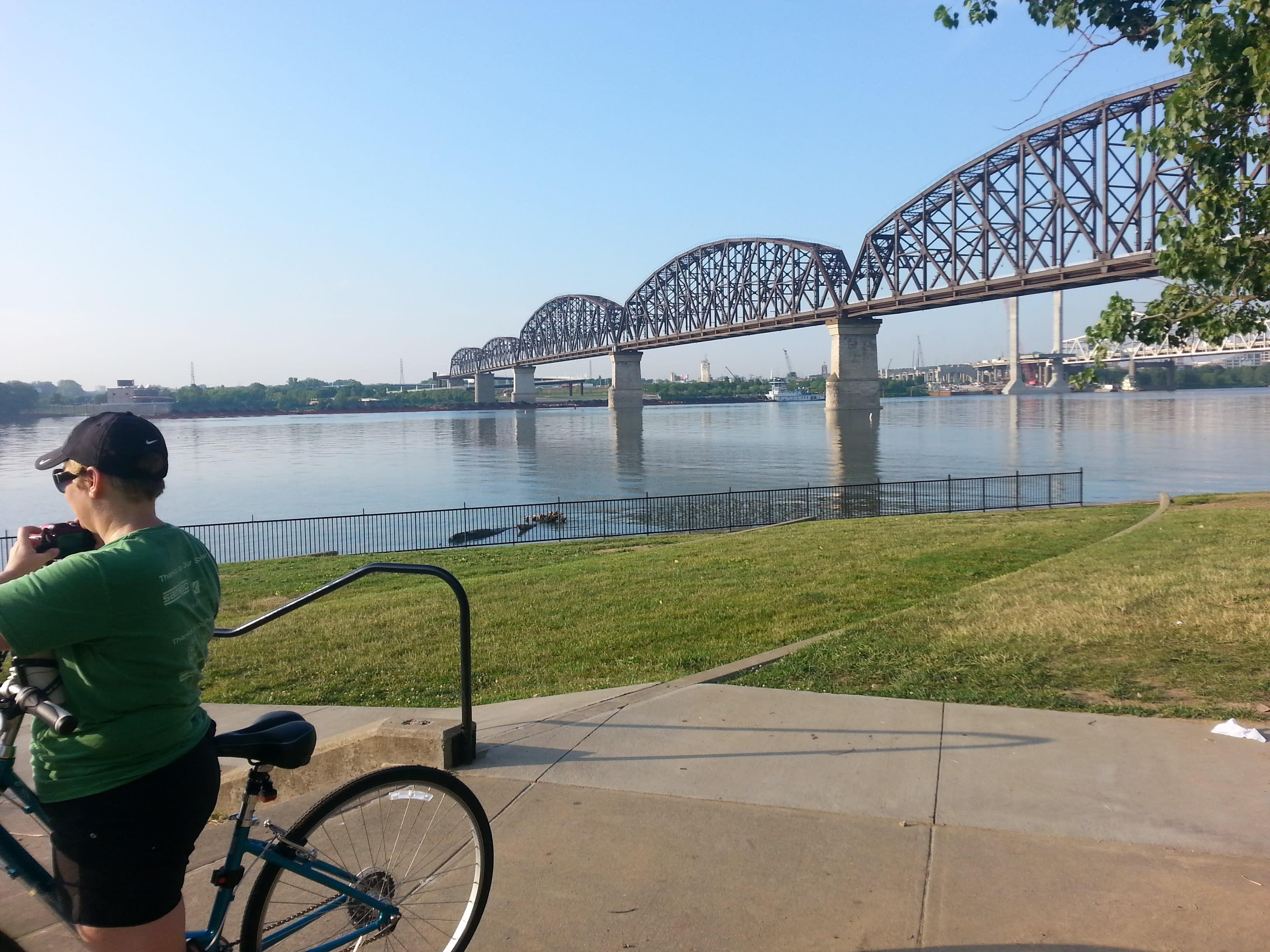 Cyclist on Greenway below Big Four Bridge