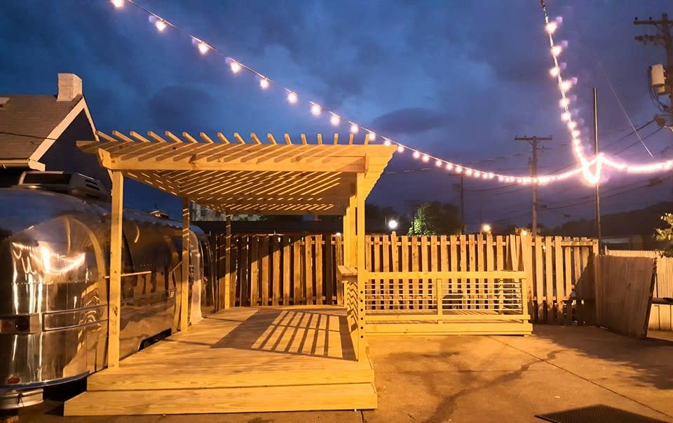 Gospel Bird Outdoor patio at night, no people