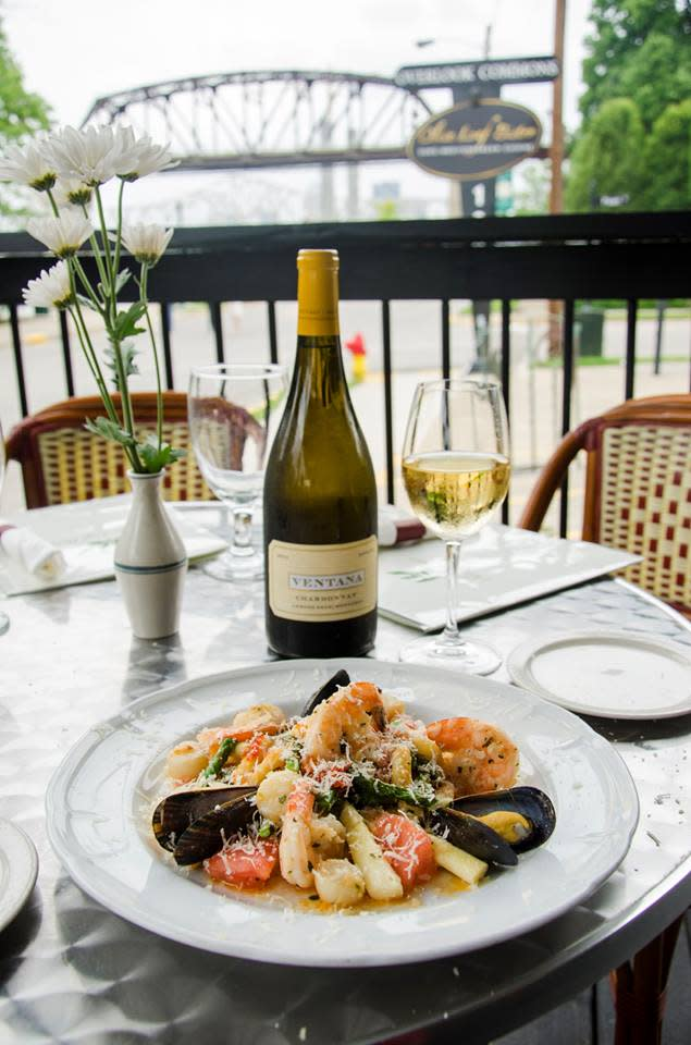 Olive Leaf Bistro, table, food, bridge in background