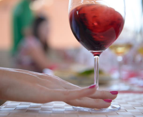 Swirling Red Wine Glass