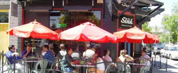 Customers dine on the The Sink Restaurant's outdoor patio